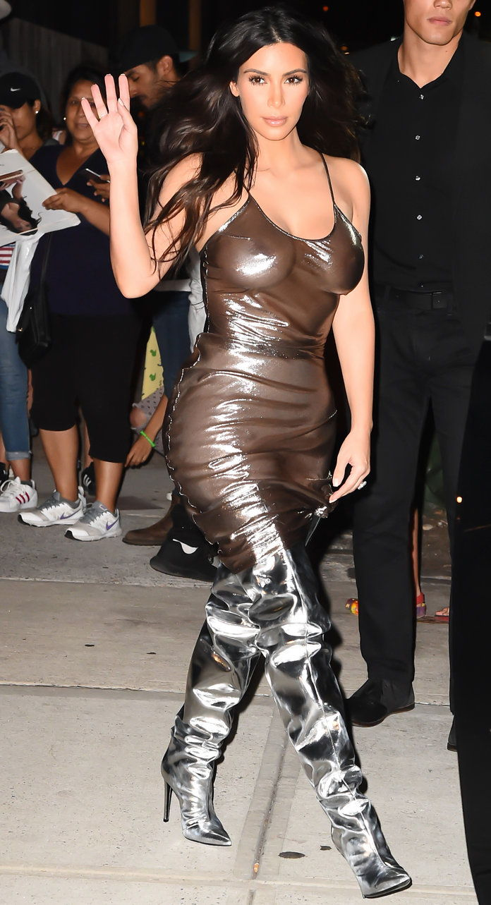 קים Kardashian West in a sheer dress and metallic thigh-highs